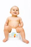 The baby on potty Royalty Free Stock Image