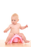 Baby on potty stock image