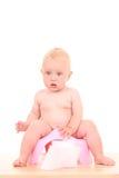 Baby on potty Stock Photos