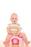 Baby on potty Royalty Free Stock Images