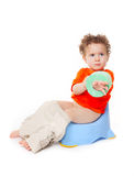 Baby  on potty with lavatory paper Stock Photos