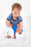Baby on potty. Little boy sitting on the potty royalty free stock images