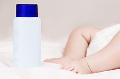 Baby with powder. Baby powder near the sleeping four month old baby in bed at home Stock Images
