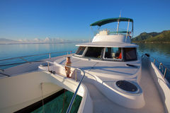 Baby on a power catamaran Royalty Free Stock Images