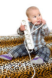 Baby with power plug Stock Photo