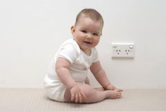 Baby and power point. Baby near Australian power point or socket Stock Photo