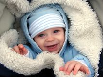 Baby in pram. Cute little baby boy (5 months) smiling in a pram in the winter time Royalty Free Stock Photo