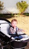 Baby in pram Stock Photo
