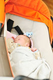 Baby in pram Stock Photography