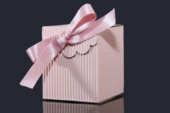 Baby Present. Present Pink box on black background Royalty Free Stock Photos