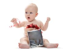 Baby with present Stock Photography