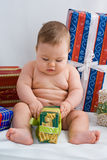 Baby and presents. Little baby and some packs Stock Photos