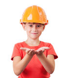 Baby in protective helmet. Supports something hands Stock Photo