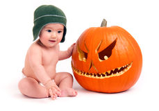 Baby Boy and Carved Halloween Pumpkin Stock Images