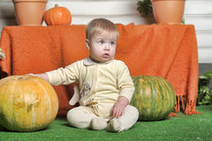 Baby with pumpkin Stock Images