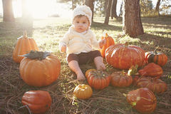 Baby at pumpkin patch Stock Photography