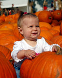 Baby in Pumpkin Patch Royalty Free Stock Photo