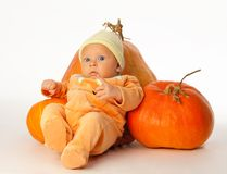 Baby with pumpkins Royalty Free Stock Photo