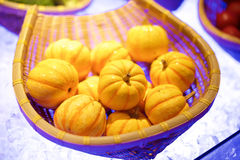 Baby pumpkins in basket Royalty Free Stock Photos