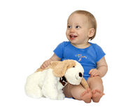 Baby with puppy. Cute baby boy holding a toy puppy stock photography