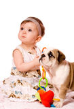 Baby and puppy. Of english bulldog isolated royalty free stock image