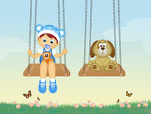 Baby and puppy on swing Stock Image