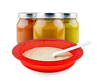 Baby puree and bowl of porridge Stock Photo