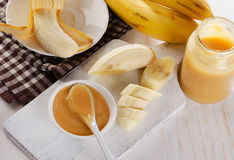 Baby puree in a jar with bananas. Stock Photography