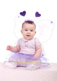 Baby in a purple dress Stock Photography