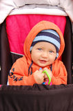 Baby in pushchair. Portrait of baby boy sitting in his pushchair Stock Image