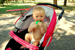 Baby in pushchair Stock Photography