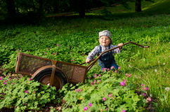 Baby pushes handcart Royalty Free Stock Photo