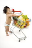 Baby pushes a shopping cart royalty free stock photos