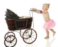 Baby Pushing Buggy Royalty Free Stock Photos