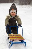 Baby pushing sled Stock Photo