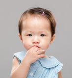 Baby put finger into mouth Royalty Free Stock Photography
