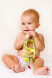 Baby putting the mask. Royalty Free Stock Photography