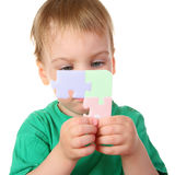 Baby with puzzle Stock Photo