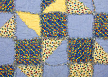 Baby quilt. With blue and yellow patches Royalty Free Stock Photos