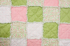 Baby quilt. With pink, green and white patches Royalty Free Stock Photos