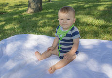 Baby on Quilt in Bow Tie Stock Photo