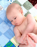 Baby on Quilt - Contentment Royalty Free Stock Images