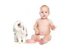 Baby with a rabbit Stock Photo