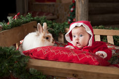 Baby with rabbit, Christmas time Royalty Free Stock Image