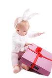 Baby in rabbit costume with pink gift Royalty Free Stock Photography