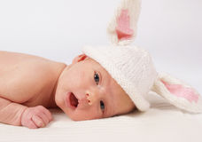 Baby with rabbit-cup Royalty Free Stock Photos