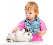 Baby with rabbit Stock Image