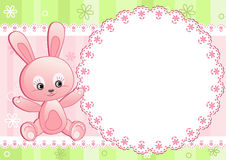 Baby rabbit and white doily. Royalty Free Stock Photo