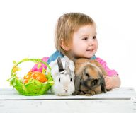 Baby with rabbits Royalty Free Stock Photography