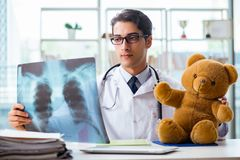 The baby radiologist with x-ray image Stock Photos